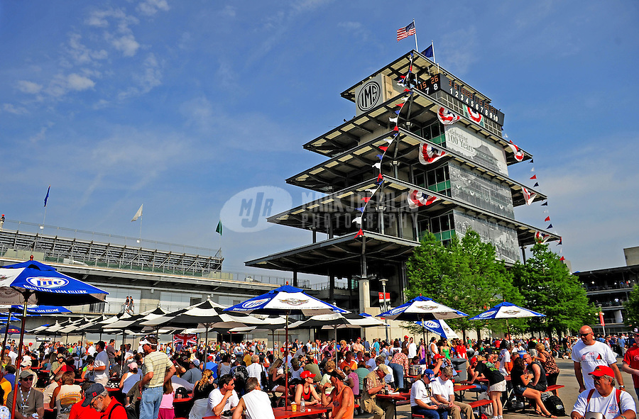 May 24, 2009; Indianapolis, IN, USA; IRL fans congregate beneath the pagoda prior to the 93rd running of the Indianapolis 500 at Indianapolis Motor Speedway.  Mandatory Credit: Mark J. Rebilas-