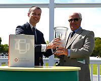 Connections of Time Change receive their trophy for winning The Smith & Williamson British EBF Fillies' Handicap (Class 3)  during Afternoon Racing at Salisbury Racecourse on 17th May 2018