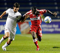 DC United defender Facundo Erpen (5) and Chicago Fire midfielder Thiago (10) battle for the ball.  The Chicago Fire defeated the DC United 3-0 in the semifinals of the U.S. Open Cup at Toyota Park in Bridgeview, IL on September 6, 2006...