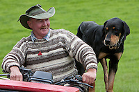 A Musterer (Shepherd) and his Sheep Dog, near Masterton, Wairarapa region, north island, New Zealand.  This dog is a huntaway dog, used to drive sheep out into the field for grazing.