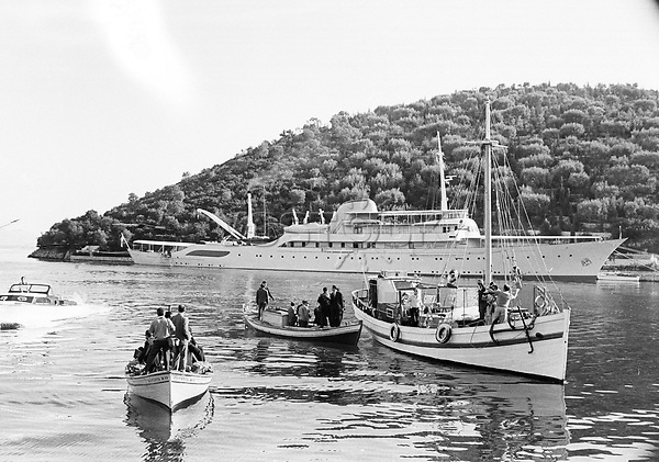 Boatloads of newsmen and press photographers approach the Onassis  yacht Christina anchored off the island of Skorpios prior to the wedding of Jackie Kennedy to Aristotle Onassis<br />
