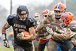 ANSONIA, CT. 02 December 2018-120218 - Ansonia's Tyler Cafaro #17 runs with the ball along the sidelines against Bloomfield's Nathan Quinones #72, and Bloomfield's Caleb Goodison #28 during the Class S Semi-final game between Bloomfield and Ansonia at Ansonia High School in Ansonia on Sunday. Bloomfield held on to beat Ansonia 26-19 and advances to the Class S Championship game next week. Bill Shettle Republican-American