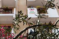 Balcony of Borsellino&rsquo;s Family: &quot;You did not kill them: their ideas walk on our legs&quot;.<br /> <br /> Palermo (Sicily - Italy), 19/07/2017. &quot;Basta depistaggi e omert&agrave; di Stato!&quot; (&quot;Stop disinformation and omert&aacute; by the State!&quot;) (1). Public event to commemorate the 25th Anniversary of the assassination of the anti-mafia Magistrate Paolo Borsellino along with five of his police &ldquo;scorta&rdquo; (Escorts from the special branch of the Italian police force who protect Judges): Agostino Catalano, Emanuela Loi (The first Italian female member of the police special branch and the first woman of this branch to be killed on duty), Vincenzo Li Muli, Walter Eddie Cosina and Claudio Traina. The event was held at Via D'Amelio, the road where Borsellino was killed. Family members of mafia victims, amongst others, made speeches about their dramatic experiences, mafia violence and unpunished crimes, State cover-ups, silence ('omert&aacute;'), and misinformation. Speakers included, amongst others, Vincenzo Agostino &amp; Augusta Schiera, Salvatore &amp; Cristina &amp; Antonella Catalano, Graziella Accetta &amp; Ninni Domino, Massimo Sole, Paola Caccia, Luciano Traina, Gianluca &amp; Angela Manca, Nunzia &amp; Stefano Mormile, Ferdinando Imposimato, Judge Nino Di Matteo. The event ended with the screening of the RAI docu-fiction, 'Adesso Tocca A Me' ('Now it's My Turn' - Watch it here: http://bit.ly/2w3WJUX ) by G. Filippetto &amp; F. Miccich&egrave;.<br /> <br /> For more info &amp; a video of the event please click here: http://bit.ly/2eQfNT3 &amp; http://bit.ly/2eQbmrj &amp; http://19luglio1992.com &amp; http://bit.ly/2he8hCj<br /> <br /> (1) 'Omerta' is the term used in Italy to refer to the code of silence used by mafia organisations, as well as the culture of silence that is entrenched in society at large (especially among victims of mafia crimes, as they fear recriminations), about the existence of organised crime and its acti