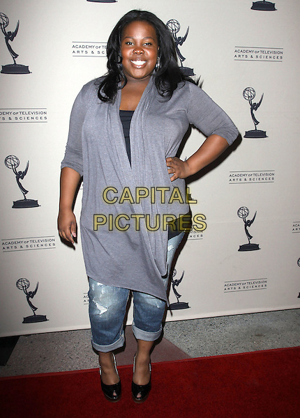 AMBER RILEY .An evening with 'GLEE' held At Leonard H. Goldenson, North Hollywood, California, USA, 26th April 2010..full length grey gray cardigan jeans turned up hand on hip denim peep toe black shoes .CAP/ADM/KB.©Kevan Brooks/AdMedia/Capital Pictures.