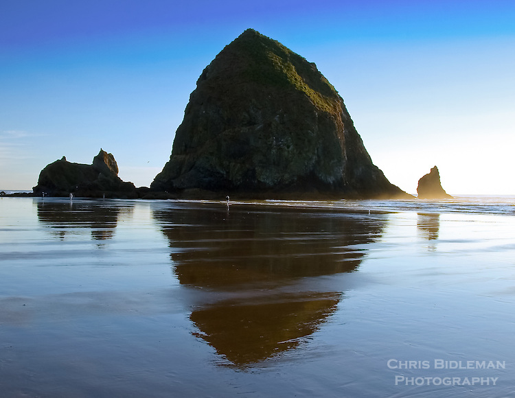 Gift card photo of Haystack Rock at Cannon Beach, OR at sunset and lowtide provides a nice reflection in the sand from the Pacific Ocean