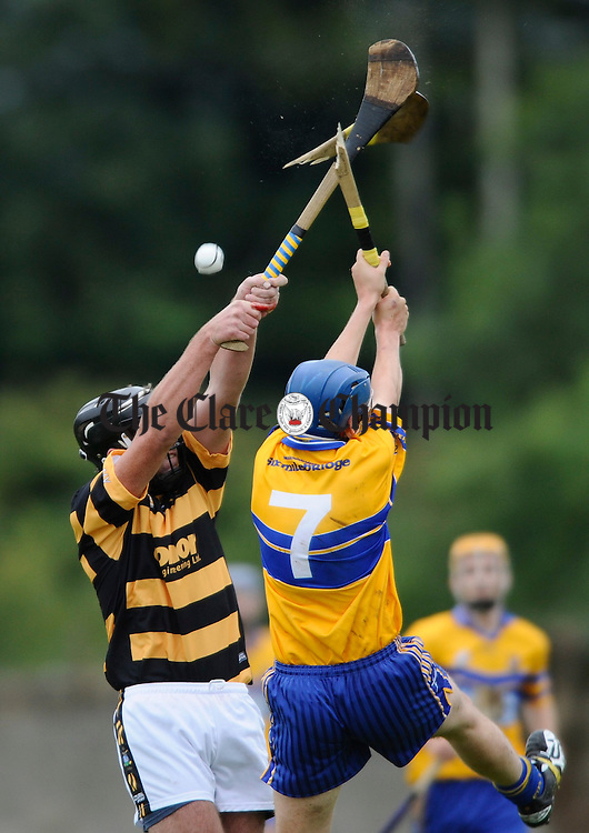 Tubber's Barry O Connor and Sixmilebridge's Barry O Connor smash ash during their championship game at Tulla. Photograph by John Kelly.