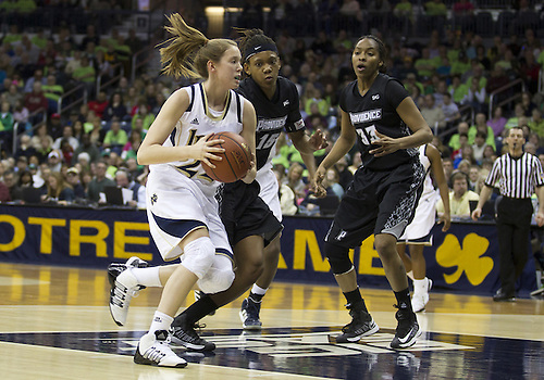 January 26, 2013:  Notre Dame guard Madison Cable (22) drives to the basket as Providence forward Chanise Baldwin (15) defends during NCAA Basketball game action between the Notre Dame Fighting Irish and the Providence Friars at Purcell Pavilion at the Joyce Center in South Bend, Indiana.  Notre Dame defeated Providence 89-44.