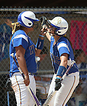Wildcats Briauna Carter, left, and Kelsie Callahan talk on deck at Edmonds Sports Complex Carson City, Nev., on Saturday, May 2, 2015.<br /> Photo by Cathleen Allison