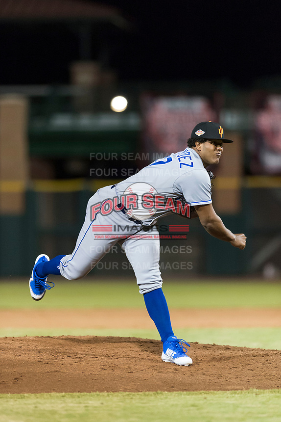 Surprise Saguaros relief pitcher Arnaldo Hernandez (37), of the Kansas City Royals, follows through on his delivery during an Arizona Fall League game against the Scottsdale Scorpions at Scottsdale Stadium on October 15, 2018 in Scottsdale, Arizona. Surprise defeated Scottsdale 2-0. (Zachary Lucy/Four Seam Images)