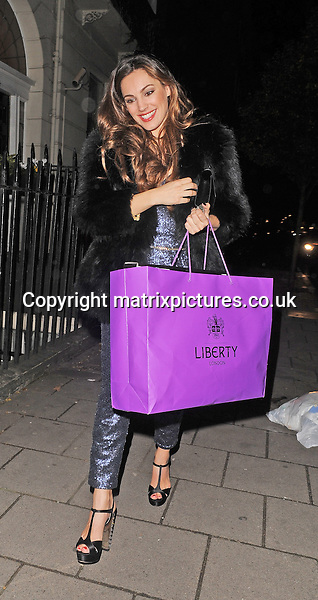 NON EXCLUSIVE PICTURE: PALACE LEE / MATRIXPICTURES.CO.UK<br /> PLEASE CREDIT ALL USES<br /> <br /> WORLD RIGHTS<br /> <br /> English model and television personality Kelly Brook is spotted as she arrives home from her 34th birthday celebrations in London, England.<br /> <br /> The popular brunette is seen wearing a sparkly blue playsuit, black and gold heels with a black fur coat, and carrying a Liberty London shopping bag filled with birthday goodies.<br /> <br /> NOVEMBER 24th 2013<br /> <br /> REF: LTN 137561