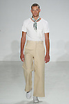 Model walks runway in a white pocket tee, wide leg cream canvas trouser and A.M. Club Palm leaf silk scarf, from the Palmiers du Mal Spring Summer 2017 collection by Brandon Capps and Shane Fonner, at Skylight Clarkson Square on July 14 2016, during New York Fashion Week Men's Spring Summer 2017.