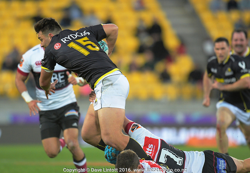 Peter Umaga-Jensen is tackled during the Mitre 10 Cup rugby union match between Wellington Lions and North Harbour at Westpac Stadium, Wellington, New Zealand on Saturday, 3 September 2016. Photo: Dave Lintott / lintottphoto.co.nz