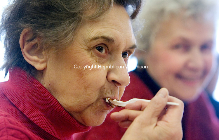 WOODBURY CT. 10 February 2014-021014SV07-Rosemarie Mallon of Woodbury enjoys ice cream during the Sweetheart Ice Cream Social at the senior center in Woodbury Monday. The seniors enjoyed the ice cream to the sounds of the cello played by Thirzah Bendokas of Naugatuck.<br /> Steven Valenti Republican-American