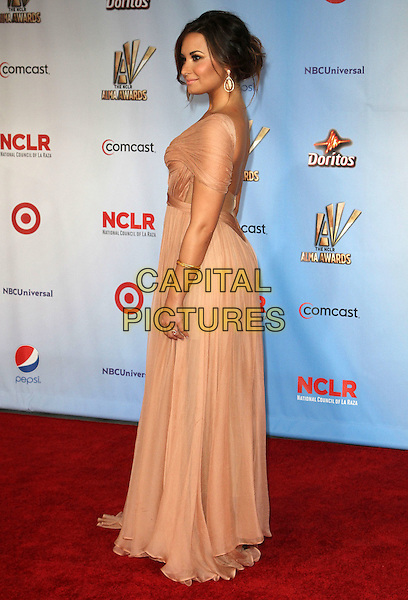 Demi Lovato.2011 NCLR ALMA Awards Held at The Santa Monica Civic Auditorium, Santa Monica, California, USA,.10th September 2011 .full length beige nude dress pleated long maxi grecian gold bracelets side .CAP/ADM/KB.©Kevan Brooks/AdMedia/Capital Pictures.