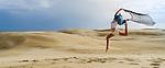 Dancing in the sand dunes. Stockton Beach Sand dunes Worimi Conservation Lands. Anna Bay, Port Stephens, NSW, Australia