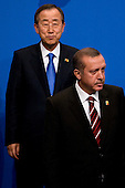 Pittsburgh, PA - September 25, 2009 -- Ban Ki-Moon, secretary-general of the United Nations, left, and Recep Erdogan, prime minister of Turkey, wait for a Group of 20 nations family photo on day two of the G-20 summit in Pittsburgh, Pennsylvania, U.S., on Friday, September 25, 2009. G-20 leaders are working on an accord to prevent a repeat of the worst global financial crisis since the Great Depression and ensure a sustained recovery. .Credit: Andrew Harrer / Pool via CNP