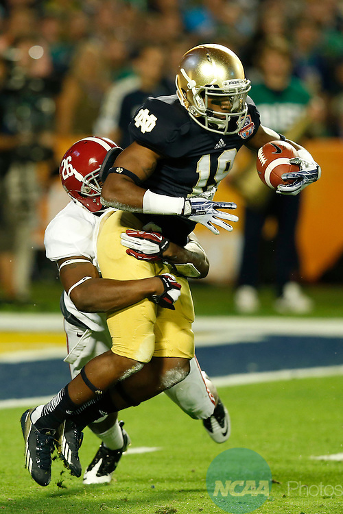 07 JAN 2013:  Landon Collins (26) of the University of Alabama tackles kick returner Davonte' Neal(19) of the University of Notre Dame inside the Irish 10 yard line during the Discover BCS National Championship game held at Sun Life Stadium in Miami Gardens, FL.  Alabama defeated Notre Dame 42-14 for the national title.  Jamie Schwaberow/NCAA Photos