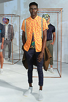 Model poses in an outfit from the Descendant Of Thieves Spring Summer 2018 collection by Matteo Maniatty, for New York Mens Day at Dune Studios on July 10, 2017; duing New York Fashion Week: Mens Spring Summer 2018.