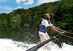 Southbury, CT- 17 July 2015-071715CM06-  Dale Lane holds onto a boom arm as he learns how to waterski on Lake Zoar in Southbury on Friday.  Lane who is visually impaired was leaning to waterski with the help of Leap of Faith Adaptive Skiers, an organization based out of Newton, CT.   Christopher Massa Republican-American