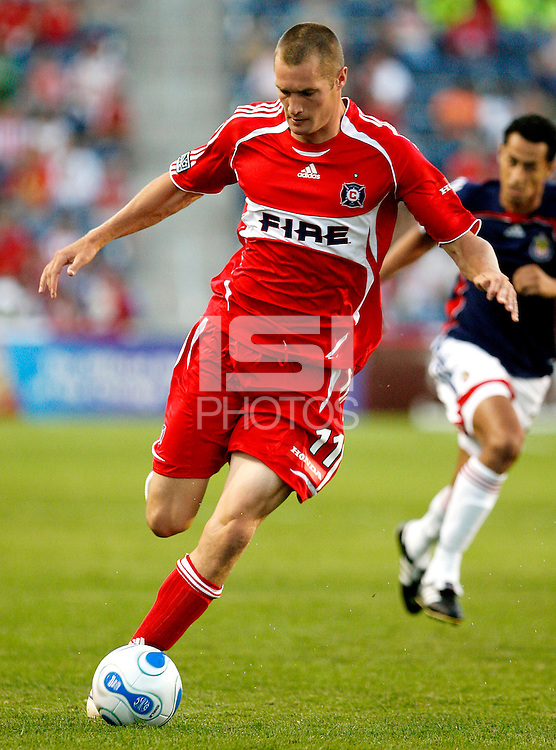 Chicago Fire forward Nate Jaqua (11) prepares to kick the ball.  Chivas USA defeated the Chicago Fire 2-1 at Toyota Park in Bridgeview, IL on August 12, 2006.