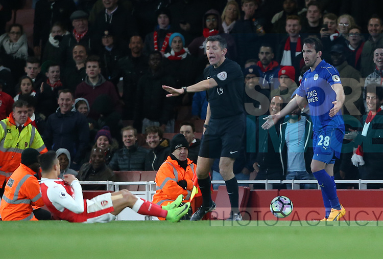 Leicester's Christian Fuchs tussles with Alexis Sanchez during the Premier League match at the Emirates Stadium, London. Picture date: April 26th, 2017. Pic credit should read: David Klein/Sportimage