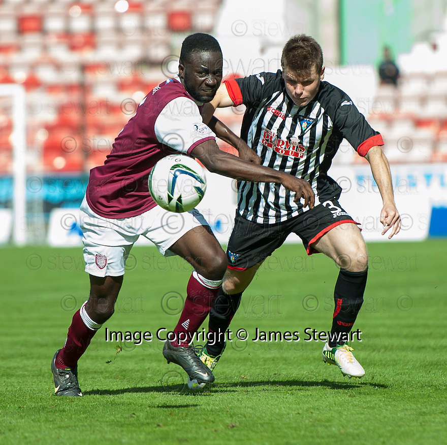 Arbroath's David Banjo and Pars' Alex Whittle challenge for the ball.