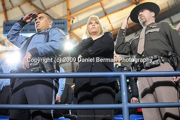 Police officers and the public salute fallen officers during a memorial service for four slain police officers in Tacoma, WA Tuesday December 8, 2009. The memorial brought an estimated 20,000 police officers and community members to the area.