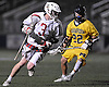 Mac O'Keefe #3 of Syosset, left, looks to get past Brendan Nichtern #22 of Massapequa during the Nassau County varsity boys lacrosse Class A final at Hofstra University on Tuesday, May 31, 2016. O'Keefe recorded seven goals and an assist in Syosset's 18-12 win.