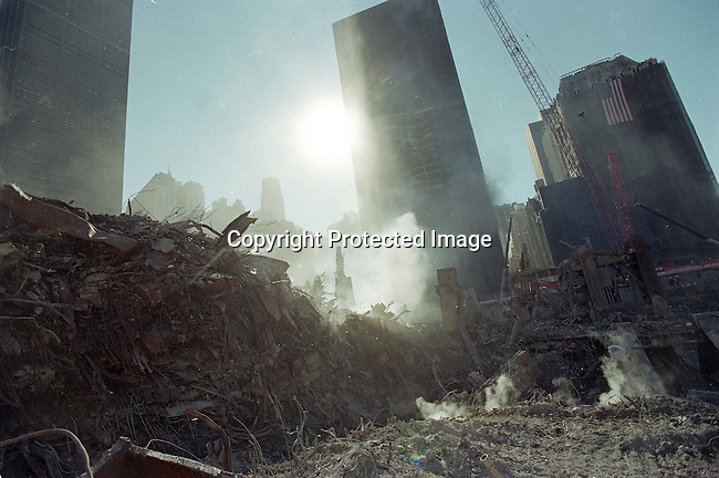"Smoke rises from piles of debris November 9, 2001 at ""ground zero"" in New York City. It is estimated that it will take a year to clear the debris from the site of the World Trade Center terror attacks. .Photo: Per-Anders Pettersson/iAfrika Photos"