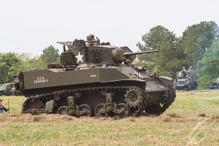 "Reenactors showcase World War II tanks, half-tracks and support vehicles during the Museum of the America G.I.'s annual Open House on March 29, 2008 in College Station, Texas. This vehicle is a M5A1 Stuart Tank named ""Suzie."""