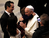 Papa Francesco abbraccia un bambino al termine del'udienza generale del mercoledi' in aula Paolo VI, Citta' del Vaticano,7 gennaio 2015.<br /> Pope Francis greets a child at the end of his weekly general audience in the Paul VI hall at the Vatican, 7 January 2015.<br /> UPDATE IMAGES PRESS/Isabella Bonotto<br /> <br /> STRICTLY ONLY FOR EDITORIAL USE