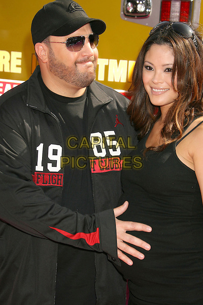 KEVIN JAMES & STEFFIANA DE LA CRUZ.2007 MTV Movie Awards held at the Gibson Amphitheater, Universal City, California, USA..June 3rd, 2007.half length black jacket dress pregnant hat baseball cap sunglasses shades couple 1985 .CAP/ADM/RE.©Russ Elliot/AdMedia/Capital Pictures *** Local Caption *** ...