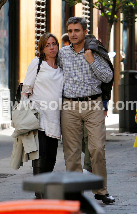 **ALL ROUND EXCLUSIVE PICTURES FROM SOLARPIX.COM**.**WORLDWIDE SYNDICATION RIGHTS EXCLUDING SPAIN - NO PUBLICATION IN SPAIN**.Spain's Defence minister Carme Chacon who married ex secretary of state Miguel Barroso in a civil ceremony, gave birth yesterday to a baby named Migquel. Carme is the first woman in history to hold this position. These pictures show the couple stroliing together in Madrid in April 2008..This pic: Carme Chacon and Miguel Barroso..JOB REF: 6461         ROL       DATE: 27.04.08.**MUST CREDIT SOLARPIX.COM OR DOUBLE FEE WILL BE CHARGED* *UNDER NO CIRCUMSTANCES IS THIS IMAGE TO BE REPRODUCED FOR ANY ONLINE EDITION WITHOUT PRIOR PERMISSION*