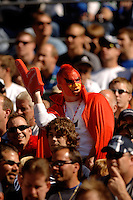 Sep 25, 2005; Seattle, WA, USA; An Arizona Cardinals fan cheers during the game against the Seattle Seahawks in the second quarter at Qwest Field. Mandatory Credit: Photo By Mark J. Rebilas