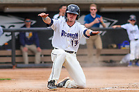 Wisconsin Timber Rattlers shortstop Trever Morrison (13) slides into home plate during a Midwest League game against the Bowling Green Hot Rods on July 22, 2018 at Fox Cities Stadium in Appleton, Wisconsin. Bowling Green defeated Wisconsin 10-5. (Brad Krause/Four Seam Images)