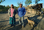 Griselda Arias and her husband David Palacios at their home in Lote 75, an indigenous neighborhood of Embarcacion, Argentina. The couple are leaders of the Wichi, who in this area were largely traditional hunters and gatherers, but they have struggled for decades to recover land that has been systematically stolen from them by cattleraisers and large agricultural plantations.