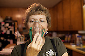 KARNES COUNTY, TX - SEPTEMBER 25, 2013: Lynn Buehring in her home, shows the mask and medicine mist that she relies on for breathing. CREDIT: Lance Rosenfield/Prime