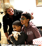 "Prospect, CT- 22 December 2016-122216CM04 Zani Barnes 4 of Waterbury holds a baby goat (called a kid) with Dakari Hathaway 9 also of Waterbury, as Kelly Cronin, looks on during a Christmas Party for Kelly's Kids at the Cronin Farm in Prospect on Thursday.  The kid was two days old and was part of an ""old fashioned farm Christmas party"" was held by Cronin, executive director at Kelly's Kids.  The program allows ""children to be children"" said Cronin.  It also helps them to learn and grow through education and recreation programs.   Christopher Massa Republican-American"