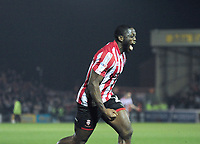 Lincoln City's John Akinde celebrates scoring his side's equalising goal to make the score 1-1<br /> <br /> Photographer Andrew Vaughan/CameraSport<br /> <br /> The EFL Sky Bet League Two - Lincoln City v Exeter City - Tuesday 26th February 2019 - Sincil Bank - Lincoln<br /> <br /> World Copyright © 2019 CameraSport. All rights reserved. 43 Linden Ave. Countesthorpe. Leicester. England. LE8 5PG - Tel: +44 (0) 116 277 4147 - admin@camerasport.com - www.camerasport.com