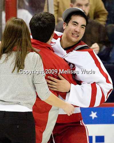 Amanda Gibson (BU - Student Manager), Patrick Walsh (BU - Student Manager), Brandon Yip (BU - 18) - The Boston University Terriers defeated the Miami University RedHawks 4-3 in overtime to win the 2009 NCAA D1 National Championship at the Frozen Four on Saturday, April 11, 2009, at the Verizon Center in Washington, DC.