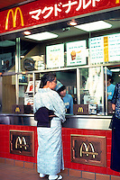 Woman in kimona at McDonalds restaurant in Kamakura Japan