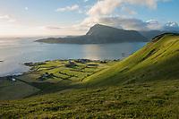 Afternoon light over green hillsides Vestvågøy from Haugheia, Lofoten Islands, Norway