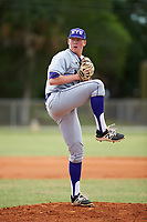 New York University Violets starting pitcher Ford Ladd (47) delivers a pitch during a game against the Edgewood Eagles on March 14, 2017 at Terry Park in Fort Myers, Florida.  NYU defeated Edgewood 12-7.  (Mike Janes/Four Seam Images)