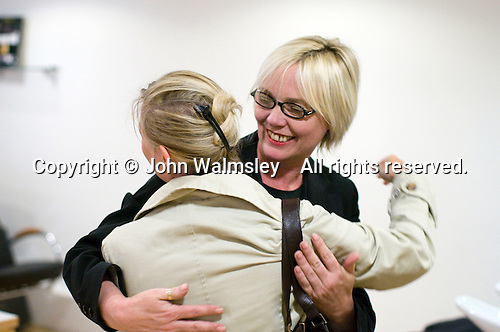 Ex-student given a celebratory hug on getting her first job, Arena Salon, Hair & Beauty Dept., Kingston College.