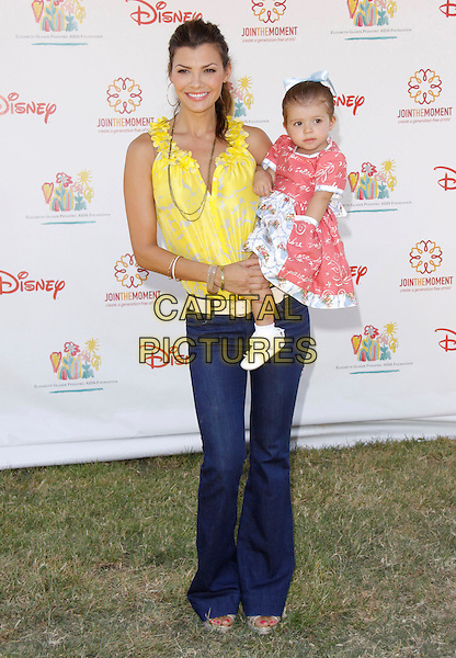 "ALI LANDRY & ESTELA.The 20th annual ""A Time for Heroes"" Celebrity Carnival benefiting Elizabeth Glaser Pediatric AIDS Foundation held at Wadsworth Theater on the Veteran Administration Lawn in West Los Angeles, California, USA. .June 7th, 2009.full length blue jeans denim yellow top lifting carrying daughter mother mom mum family pink dress.CAP/DVS                                                  .©Debbie VanStory/Capital Pictures."