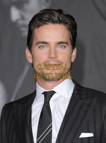 Matt Bomer.The Regency Enterprises L.A. Premiere of 'In Time' held at The Regency Village Theatre in Westwood, California, USA..October 20th, 2011.headshot portrait stubble facial hair pinstripe black suit       .CAP/RKE/DVS.©DVS/RockinExposures/Capital Pictures.
