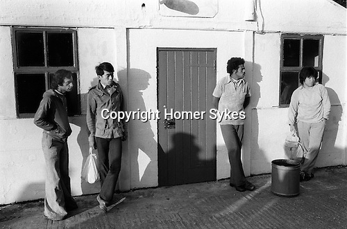Foreign student, doing casual seasonal fruit picking Wisbech Cambridgeshire, outside their accommodation black. 1977