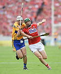 Patrick O Connor of Clare in action against Seamus Harnedy of Cork during their Munster senior hurling final at Thurles. Photograph by John Kelly.