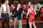 MADISON, WI - JANUARY 19: Head coach Barry Davis of the Wisconsin Badgers wrestling team coaches one of his wrestlers during their meet against the Penn State Nittany Lions at the Field House on January 19, 2007 in Madison, Wisconsin. The Badgers beat the Nittany Lions 17-16. (Photo by David Stluka)