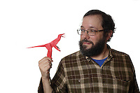 Lorne Dannenbaum with a Velociraptor designed by Stefano Bachis which he folded for the 2017 OrigamiUSA Holiday Tree